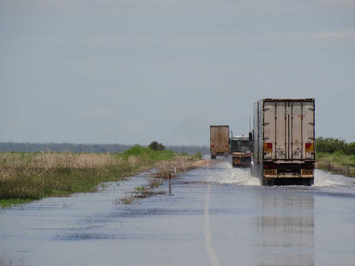 trucks on a flooded highway